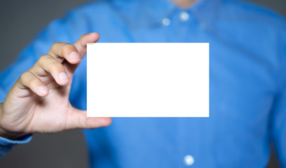 Businessman holding white business card.