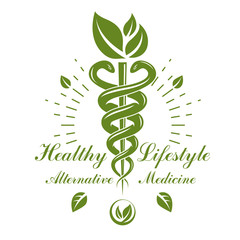 Caduceus vector conceptual emblem created with snakes and green leaves. Wellness and harmony metaphor. Alternative medicine concept, phytotherapy logo.