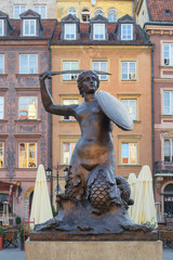 Mermaid statue Syrenka of Warsaw Old Town Market Square
