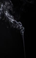 Vertical smoky cloud of aromastick