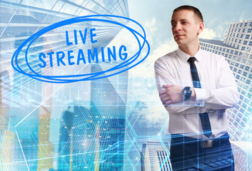 The concept of business, technology, the Internet and the network. Young businessman showing inscription: Live streaming