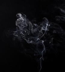 White smoke of smoldering aroma stick