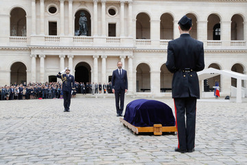 French Prime Minister Edouard Philippe stands in front of the coffin of late French industrialist Serge Dassault during a funeral military ceremony in the Hotel des Invalides courtyard in Paris
