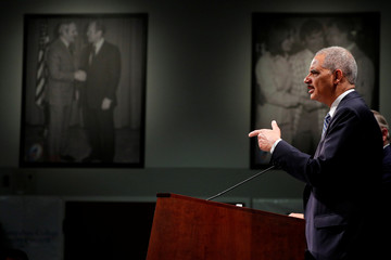Former U.S. Attorney General Eric Holder speaks at a Politics and Eggs event at the New Hampshire Institute of Politics at St. Anselm College in Manchester