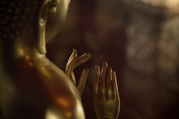 Hands of Golden Buddha images in different attitudes sculpture at Wat Krathum Suea Pla temple ,Bangkok