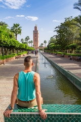 A boy posing in front of the Koutoubia mosque in Marrakech