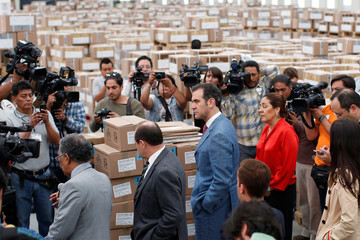 President of the National Ectoral Institute (INE), Lorenzo Cordova, takes a tour to see the boxes of voting materials for the upcoming July 1 presidential election, stored in Tepotzotlan