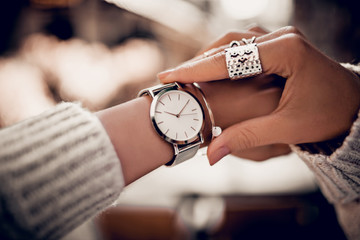 Silver watch on woman hand