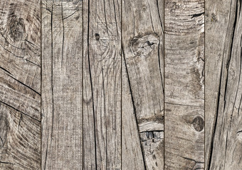 Photograph of old weathered cracked knotted Pine wood floorboards grunge texture detail