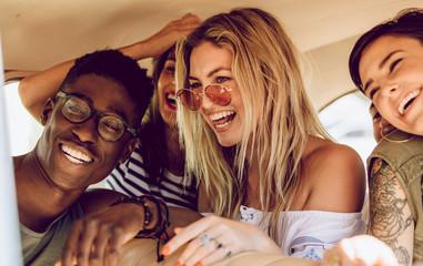 Friends enjoying on a road trip