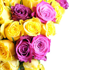 Beautiful bouquet of pink and uellow roses flowers on left side of the Photo isolated on white background closeup