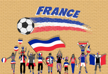 French football fans cheering with France flag colors in front of soccer ball graffiti