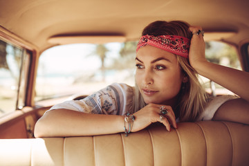 Beautiful woman in a car looking away and thinking