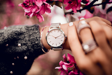 Beautiful silver watch on woman hand