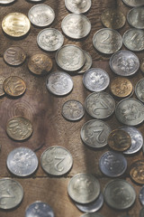 russian coins of white and yellow metal on wooden surface at sunny day