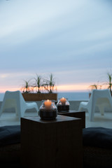 Dusk on patio in Baja California Sur with lit candles and ocean view
