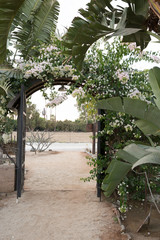 Arch with banana leaves and flowers in Mexico