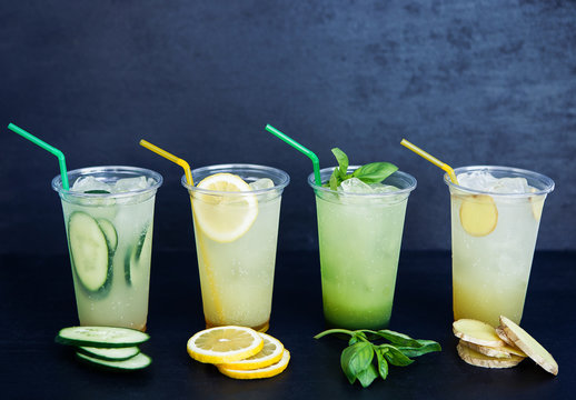 Lemonade with four different tastes on the black background
