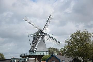 Foto auf Acrylglas Mühlen Windmühle De Gouden Engel bei Alkmaar