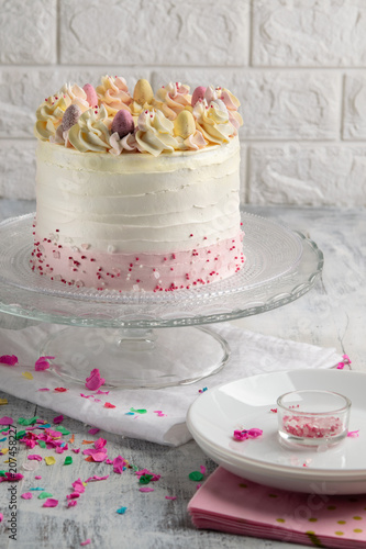 White Buttercream Birthday Cake With Colorful Bunting Ansprinkles And Banner Happy Over Background