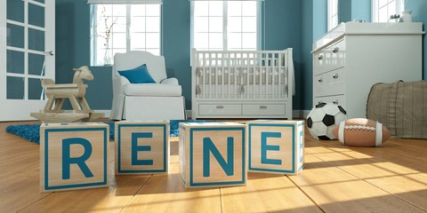 The name rene written with wooden toy cubes in children's room