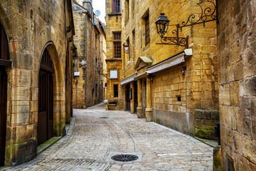 Narrow street in the Old Town of Sarlat, Perigord, France
