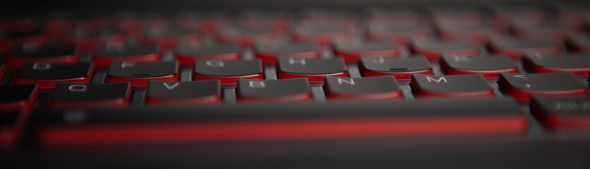 keyboard texture pattern macro. Closeup of laptop keyboard illumination, backlit keyboard