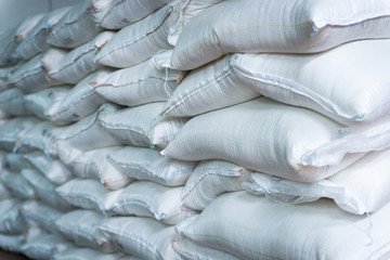 Stack of sugar or flour bags in warehouse