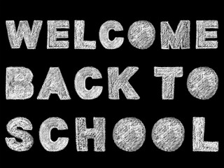 handwritten white bold chalk lettering welcome back to school text on black background, hand-drawn chalk phrase, back to school concept, stock photo image