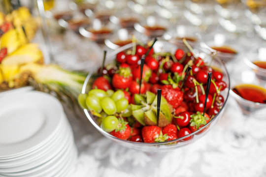Wedding reception, decor table of fruits and caces