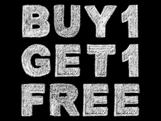 handwritten white bold chalk lettering buy 1 get 1 free text on black background, hand-drawn chalk phrase, back to school concept, stock photo image