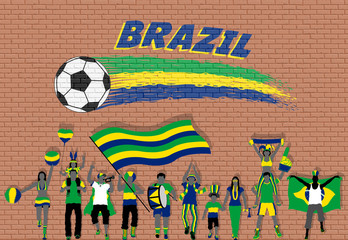 Brazilian football fans cheering with Brazil flag colors in front of soccer ball graffiti