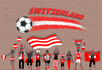Swiss football fans cheering with Switzerland flag colors in front of soccer ball graffiti
