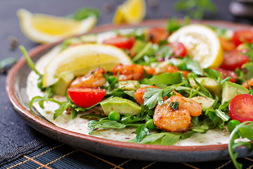 Shrimps tortilla tacos open face wrap with fresh vegetables. Healthy food. Mexican meal.