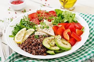 Vegetarian Buddha bowl with quinoa, tofu cheese and fresh vegetables. Healthy food concept. Vegan salad.