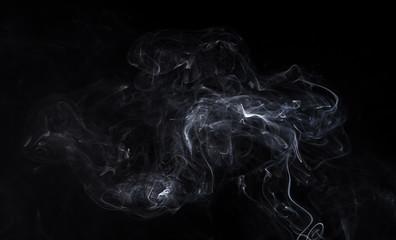 White smoky cloud of smoldering aromastick