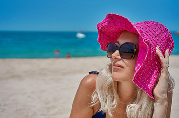 girl in a hat on the beach