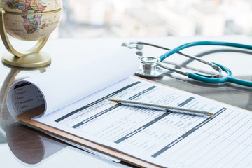 Medical health care record, patients discharge, or prescription form paperwork in hospital clinic with doctor's stethoscope