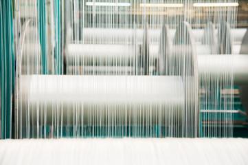 Yarn thread running in the machine Fototapete