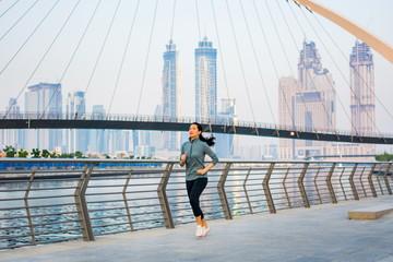 Girl running in a modern city environment