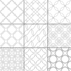 Light gray geometric ornaments. Collection of seamless patterns