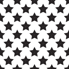 Geometric seamless pattern of black stars with glitter isolated on white background.