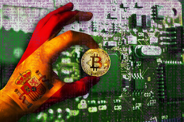 Bitcoin cryptocurrency Spain flag Binary code Golden Coin of Bitcoin in the Spanish flag hand between two fingers shows OK sign on a chip background