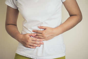 Woman Burning in the chest suffering from acid reflux or heartburn, diarrhea, indigestive problem