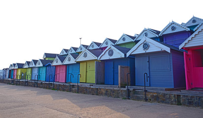 Colourful beach huts at sunset in England
