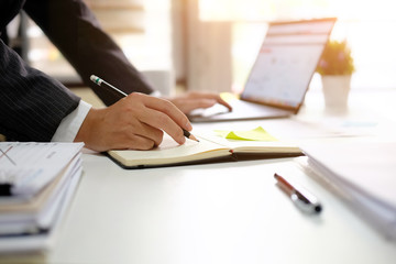 Business analysis investment and writing on paper note with morning light startup business.