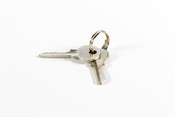 Wad of keys with two small keys isolated on white background
