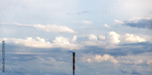 89b6832ff Pipe with smoke on the background of beautiful clouds.