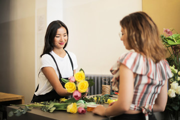 Smiling florist serving a customer