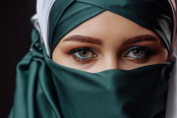 beautiful muslim girl with hided face. close up cropped photo. pretty eyes